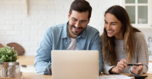 Couple looking at preapproved vs prequalified loan offers